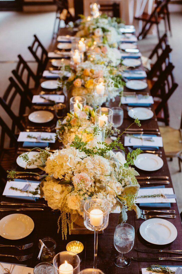 Lush white reception table centerpieces
