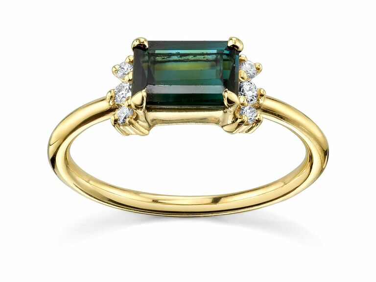 east-west emerald-cut blue-green tourmaline ring with diamond baguettes