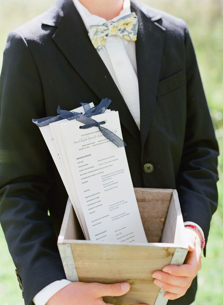 The simple programs were designed to match the invitation suite. A mesh bow on the top finished the look.