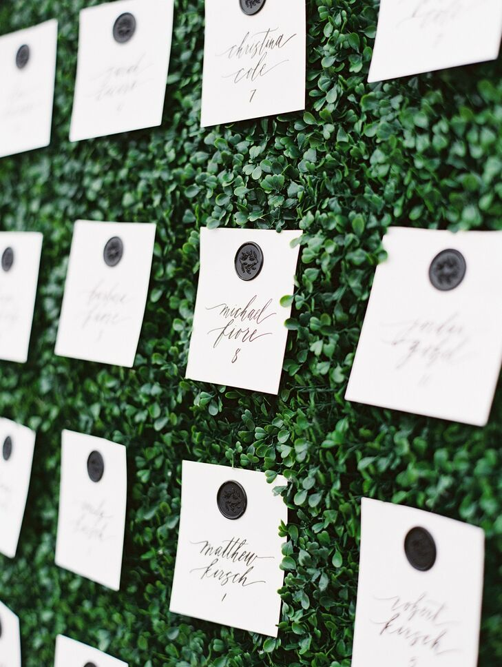 Black-and-White Escort Cards on Boxwood Hedge at Wye River Estate Wedding