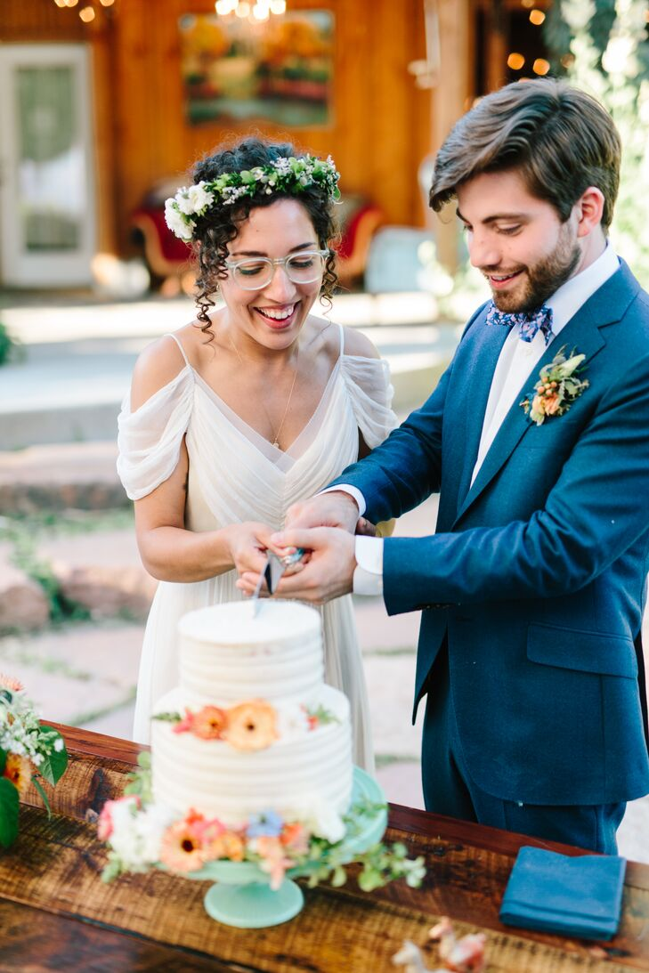 Bohemian Bride and Groom Cutting Cake