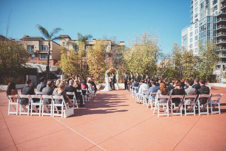 The wedding ceremony took place on the outdoor patio at El Cortez in downtown San Diego.