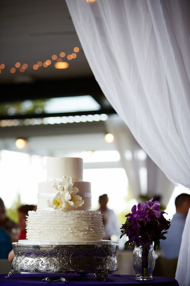 The bottom tier of Stephanie and Nathan's wedding cake consisted of a vanilla bean cake with strawberry filling. They chose a chocolate cake with chocolate buttercream for the middle tier while carrot cake with cream cheese icing filled the top tier.