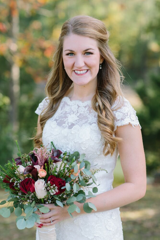 "Megan's bridal gown was an ivory lace cap-sleeve dress with an illusion neckline from the Something Blue Shoppe in Hartselle, Alabama. She wore her long hair half pulled back in soft waves. ""I'm a very simple girl,"" Megan says. ""I don't wear a lot of makeup and like to be comfy more than anything."""