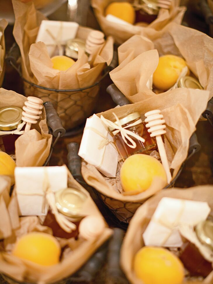 French wired baskets filled with fresh apricots, honey and local cheddar cheese wrapped in butcher paper was offered to guests as favors.