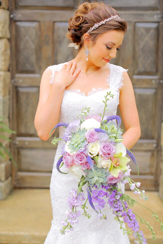 Tasha's whimsical, cascading bouquet perfectly matched the lavender and mint color palette. The arrangement included lavender and ivory roses with purple stock, unruly sprigs of veronica, a green cymbidium orchid and succulents.
