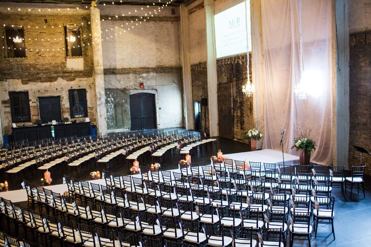 Molly and Boston had their ceremony at Aria in Minneapolis, Minnesota. The chairs were set up in a semicircle around the altar so everyone could see the couple exchange vows. A long drape behind the altar ran down the full length of the aisle to double as a backdrop and runner.