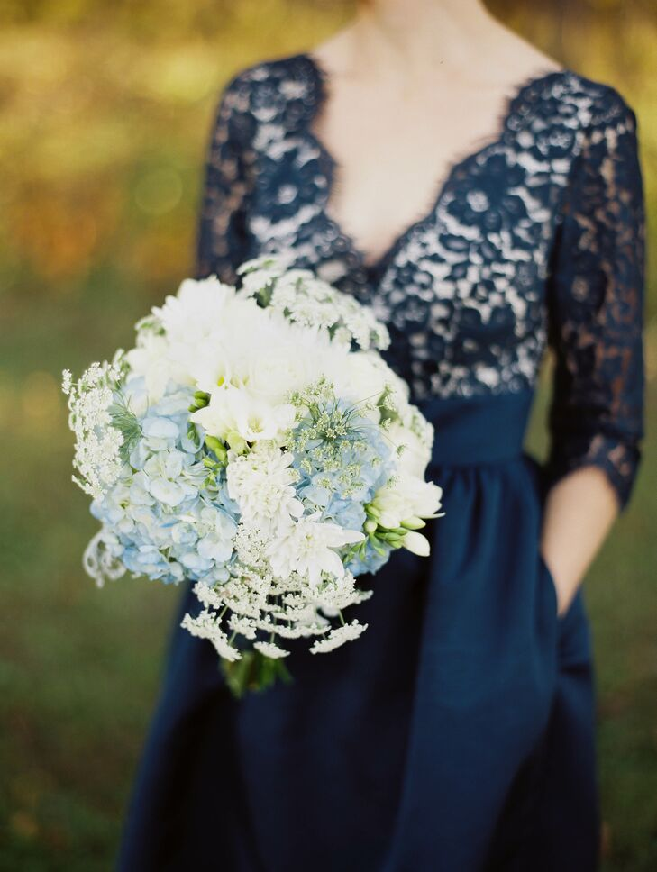 The bridesmaids carried hand-tied bouquets including hydrangeas, garden roses, freesia and queen anne's lace.