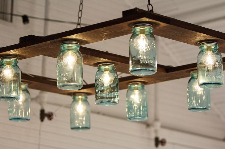 The couple created their own impressive DIY light fixture out of Mason jars, cafe lights and a wood palette.