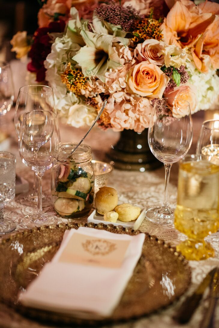 Lace linens and beaded gold chargers amped up the barn reception with a bit of glam.