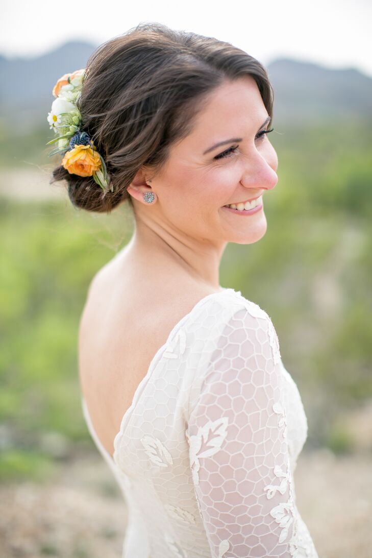 Valerie wore her hair in a low chignon with a half moon flower crown to highlight the natural details on the back of her wedding dress. For her makeup, she added drama to her eyes and kept the rest soft and romantic.