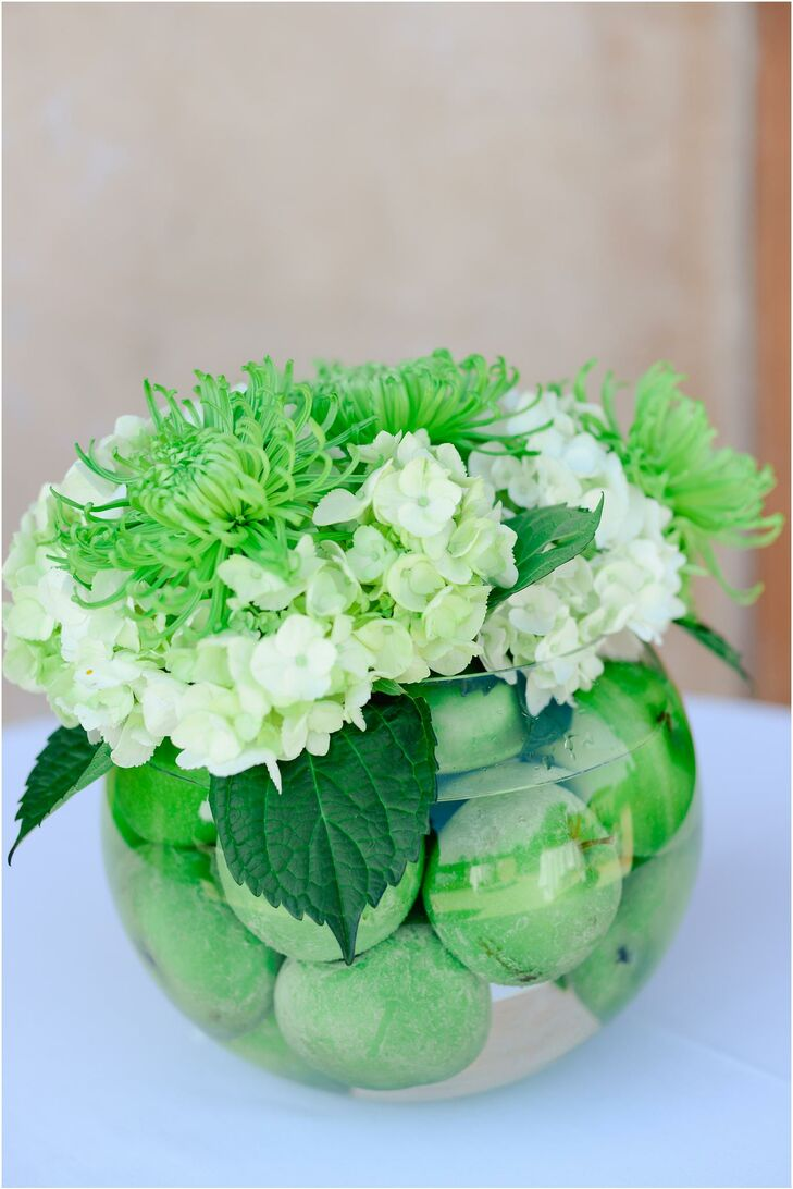 The bride and groom's color palette was inspired by peacock feathers, but they also wanted to incorporate fresh bursts of green and white to keep their theme from becoming visually overwhelming.