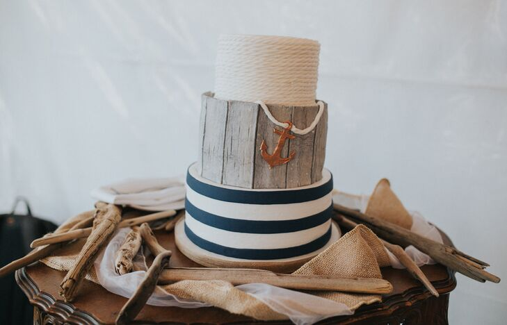The three-tier cake featured navy and white nautical stripes, a middle layer resembling weathered wood and an anchor.