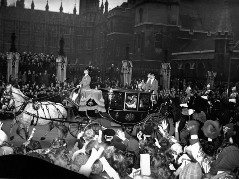 Queen Elizabeth wedding picture in carriage ride through London on wedding day