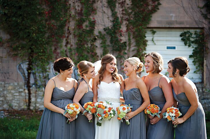 """The bridesmaids all wore gray Amsale dresses in whatever style they liked. They completed their look with custom Kendra Scott earrings and blush shoes. """"It was so important to me that they felt comfortable and beautiful on the day,"""" Maggie says."""