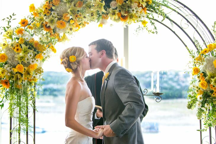 The couple used a modern, sunny color scheme of ivory, yellow and subdued gray for their bright, airy summer soiree at a beautiful lakeside resort and