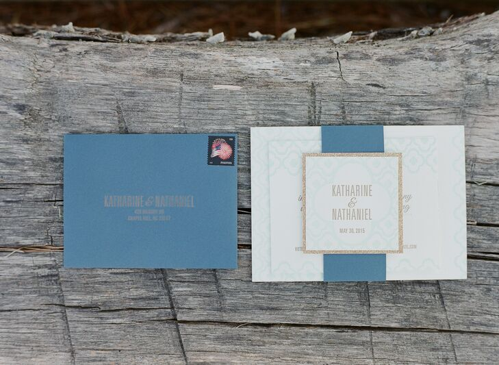 Katharine and Nate's mint and gold invitation suite featured a modern, graphic print. The invitations were bound by a gray-blue belly band accented with the couple's monogram and gold glitter.