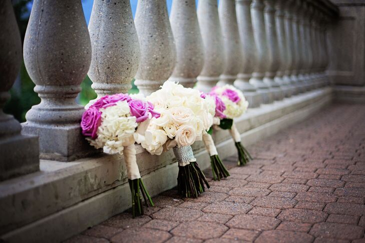 The bridesmaids carried bouquets with vibrant purple roses and white hydrangeas. Dayna carried a bouquet with blush and ivory roses.