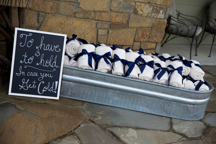 "Since Leigh and Westin got married in the winter, they gave their guests blankets for favors. ""They made a nice touch of decoration with navy bows, and a little tag said our names, wedding date and 'Love Keeps Us Warm.'"""