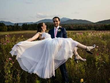 Bride wearing metallic wedding sandals with groom