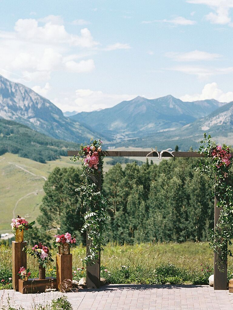 Wooden crate decor with fresh flowers for an outdoor wedding ceremony