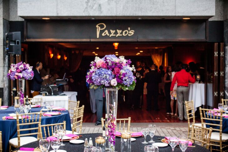 Dramatic centerpieces featured glass vases filled with signature orchids and topped with lush purple, fuchsia and pink blooms.