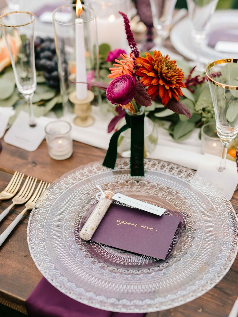 Vintage wedding reception tablescape with textured charger and gold-rimmed glasses