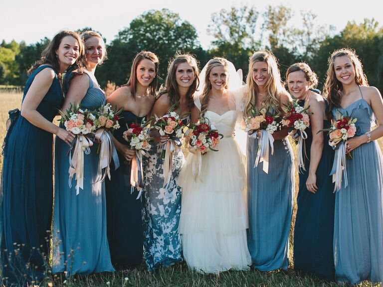 Mismatched maxi blue bridesmaid dresses and a standout, patterned maid-of-honor dress