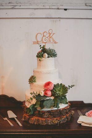 Wedding Cake With Succulents and Gold Topper