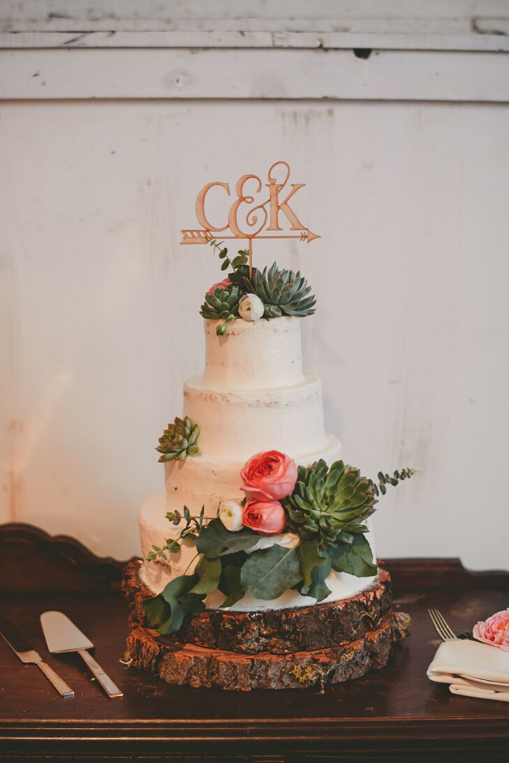 """Our cake was a partially naked olive oil, rosemary and citrus cake with lemon curd, baked by the amazing and talented co-owner of Sand Rock Farm, Jen Hagglof,"" Crystal says. ""It was topped by a laser-cut wooden topper gifted by one of my bridesmaids."""