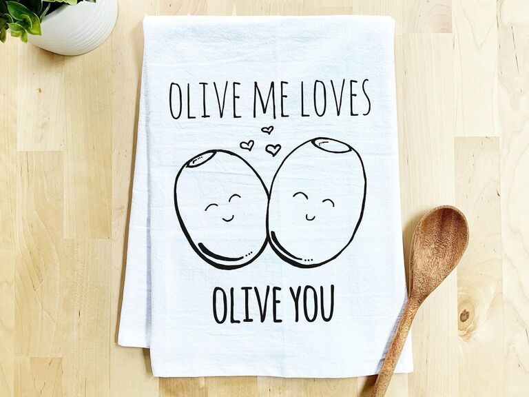 Cute dish towel with illustration of two olives that reads Olive Me Loves Olive You