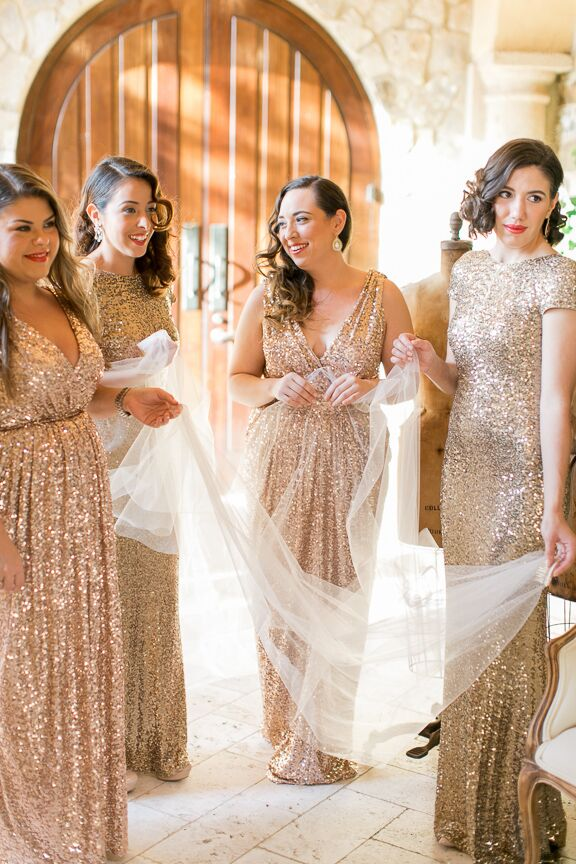 "The bridesmaids wore gold and rose gold sequin Badgley Mischka sequin dresses for an added vintage feel. ""I chose different styles to accommodate the different body types,"" says Michelle. ""I wanted them to look very glamorous."""