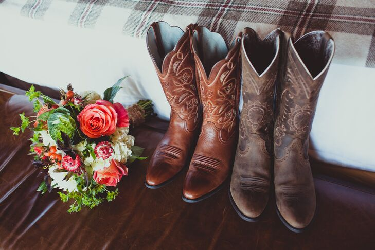 Jackie and Sarah both wore cowboy boots in different shades of brown, which were placed next to an ivory and pink bouquet.