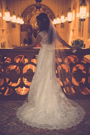 The Bride in Her Lace Cap Sleeved Gown