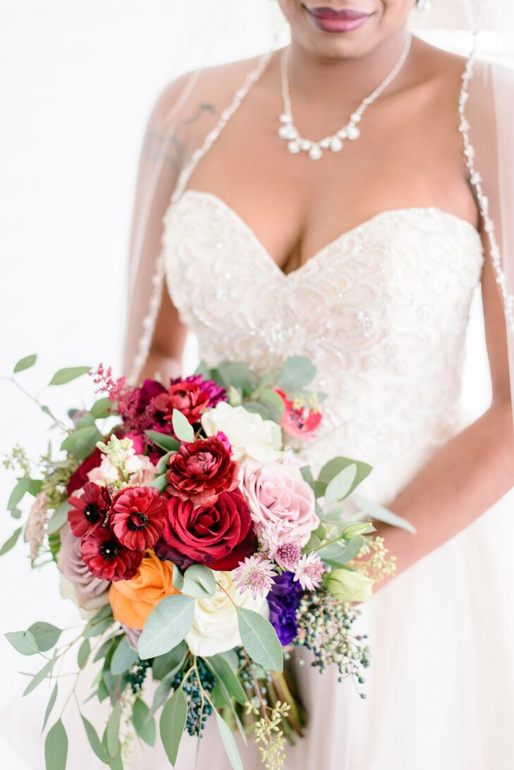 Deep red blooms were incorporated into floral arrangements to tie into Kimberlyn's palette, which included marsala red.