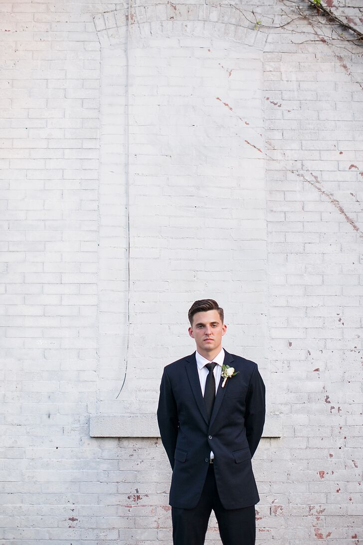 Tanner knew that the formality of a tux wasn't the look he would feel comfortable in on his big day. Instead he chose a fitted navy suite from Jos. A. Bank for himself and his groomsmen that could easily be worn again.