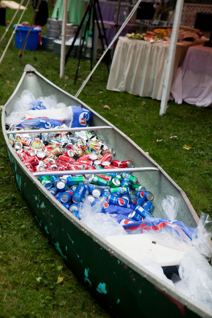 """Non-alcoholic beverages were available in a rustic canoe filled with ice. """"Zack and I would go fishing with each other and friends, so that was one thing he was really excited to have,"""" Ashley says. """"It was really significant to us."""""""