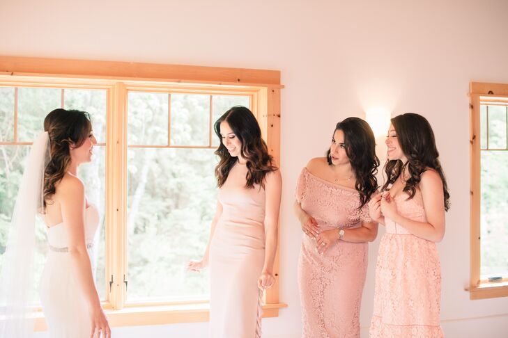 Wanting to make things easy for her bridesmaids, Nancy had her girls choose their own dresses, requesting only that they stick to soft blush tones. The girls wore their hair down in loose romantic curls and accessorized with understated jewelry.