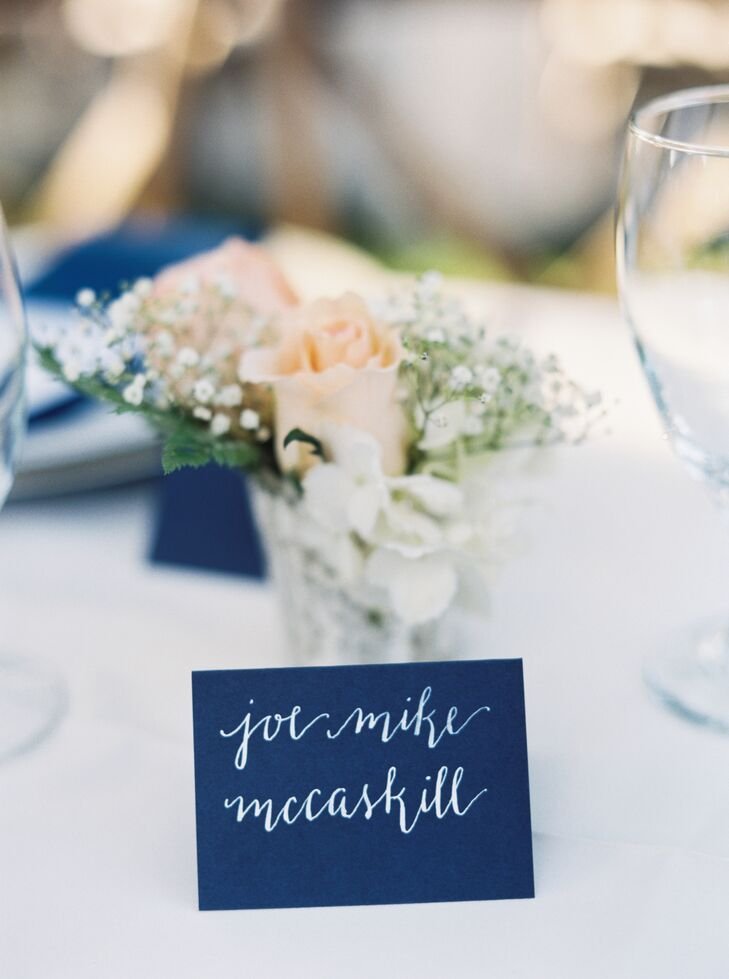 """Place cards stood out with their true navy hue as the backdrop and each guest's name spelled out in white calligraphy. The best part, however, was that the notes were made by Laurie's sister, Melissa McClellan. """"We were so pleased with our paper goods. They were one of my favorite details,"""" Laurie says."""