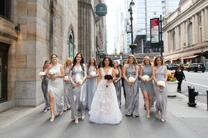 Glamorous Bridesmaids with Metallic Silver Dresses and White Bouquets