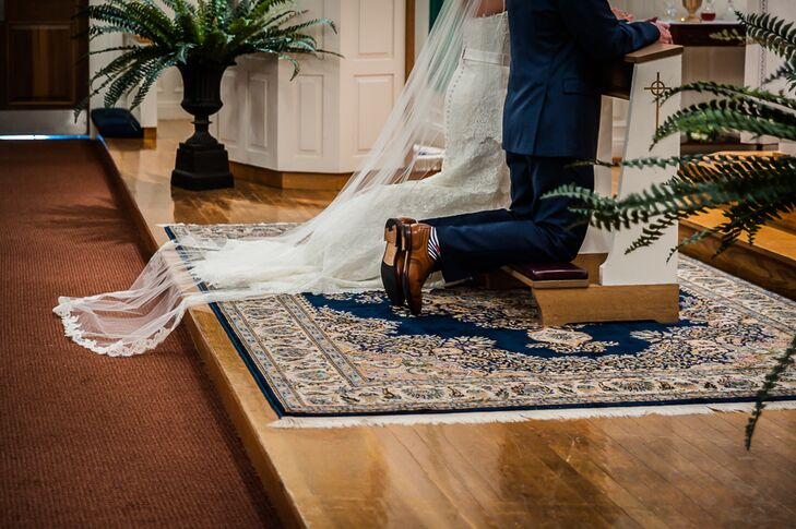 The bride and groom let their reception venue decide their ceremony location, and chose to have a traditional Catholic ceremony in a church close to the Nauticus Marina in Osterville, Massachusetts.