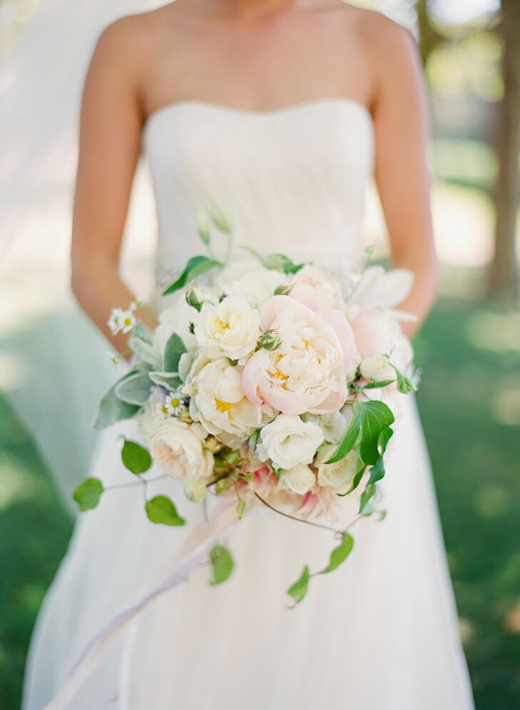 Susan's bouquet had a romantic, English garden feel with lush blooms in soft pastel colors. Pink and white peonies, roses and daisies were accented by lamb's ear and wispy vines.