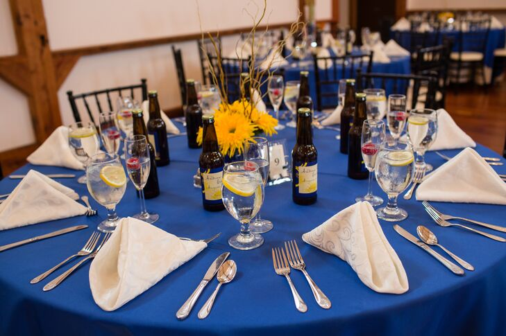 Blue Reception Tables With Sunflower Centerpieces And Homemade Beer