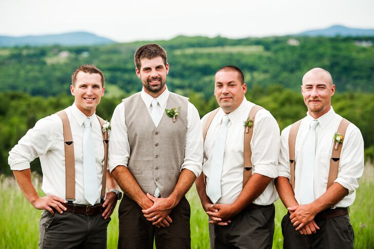 The day was all about balancing elegance and rustic flair, and Tyler's attire did just that. Instead of a full-blown suit, he donned dark brown trousers, a classic white button-down shirt, a tweed waistcoat and a striped mint-colored tie. His groomsmen wore similar ensembles, swapping out the waistcoat for caramel-colored suspenders.