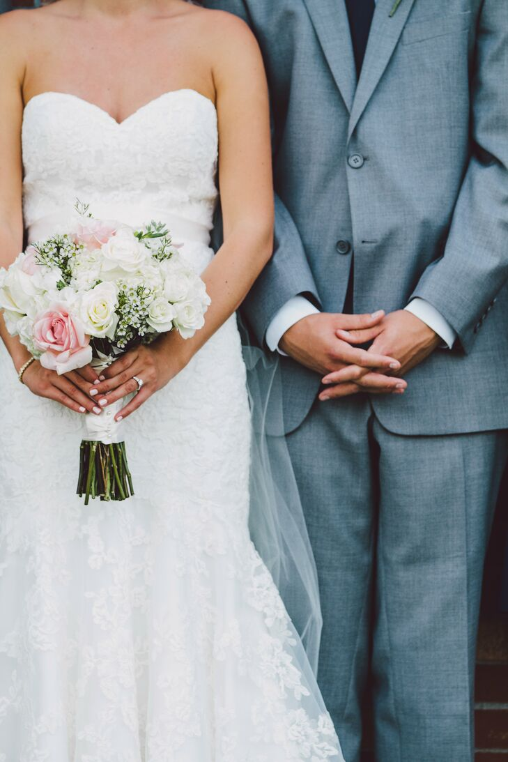 Heather's bouquet was filled with pale pink and white roses accented by wax flowers.