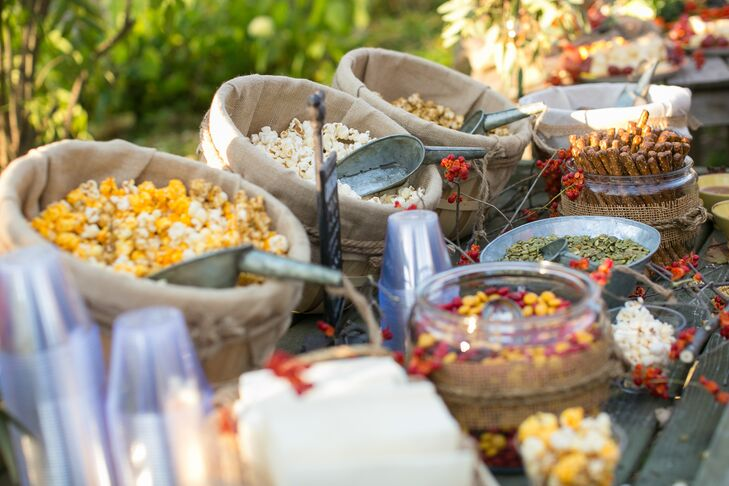 Beth and Roger, with the help of their family, served different favors of popcorn, cheese, vegetables and dips served from hollowed out pumpkins. They loved how well the food reflected the fall season and laid-back, outdoorsy wedding theme.