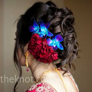 Floral-accented Curly Updo