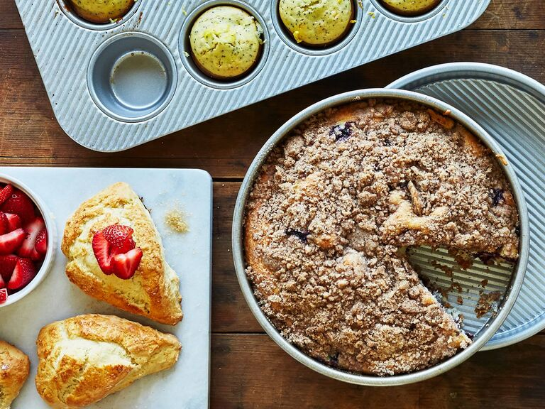 Selection of baked goods including fruit crumble and pastries