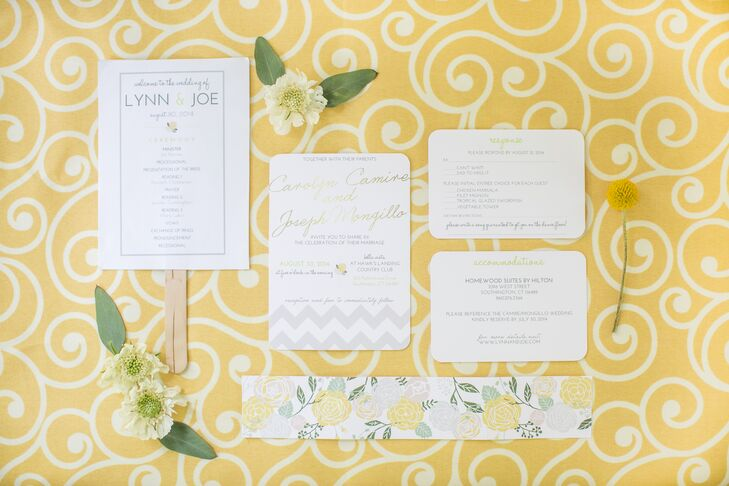"""Invitations by Stephanie created all of the couple's stationery for the wedding, The whimsical, yet modern invitations set the tone for the day with their muted palette of white, gray and yellow and playful elements like yellow floral motifs, chevron prints and calligraphy inspired fonts.  """"I wanted everything to look light, garden-inspired and fun,"""" says Lynn. """"For our response cards we even asked guests to write in a song that was guaranteed to get them on the dance floor,"""" says Lynn."""