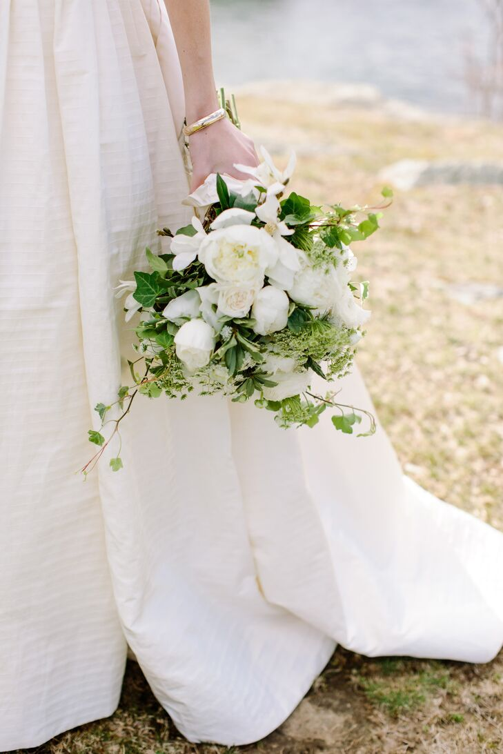 Danielle's bouquet was a generous combination of loose, organic green and white long stems, including garden roses, peonies, ivy, wildflowers and more, tied loosely with excess silk from her dress.